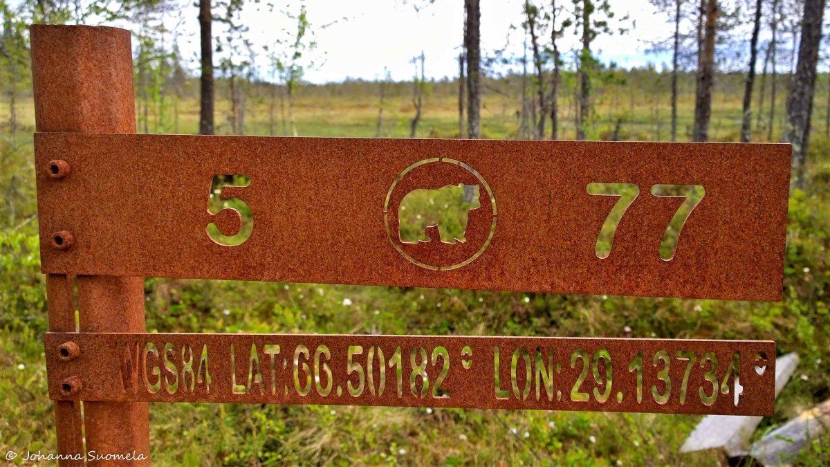 Karhunkierros viiden kilometrin kyltti